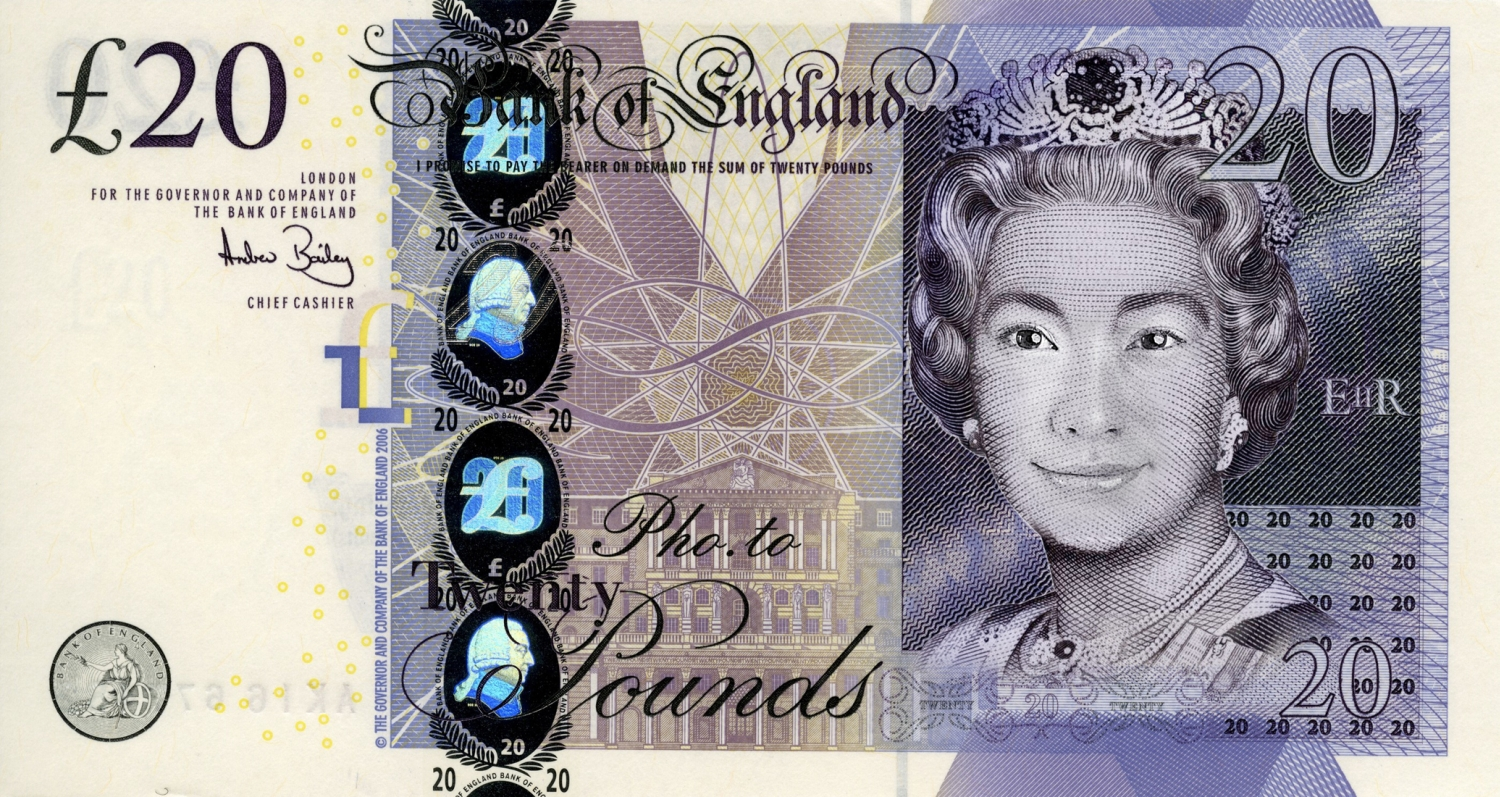 Twenty pounds sterling note with Japanese girl's face.