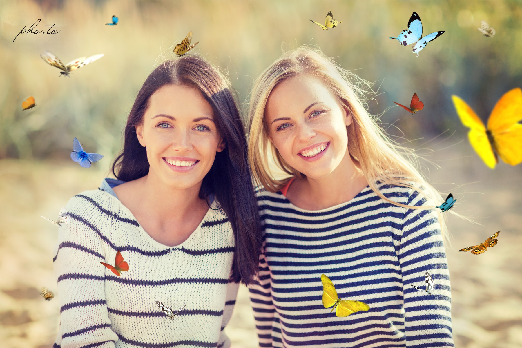 A photo of two smiling girls with butterfly overlay applied online.