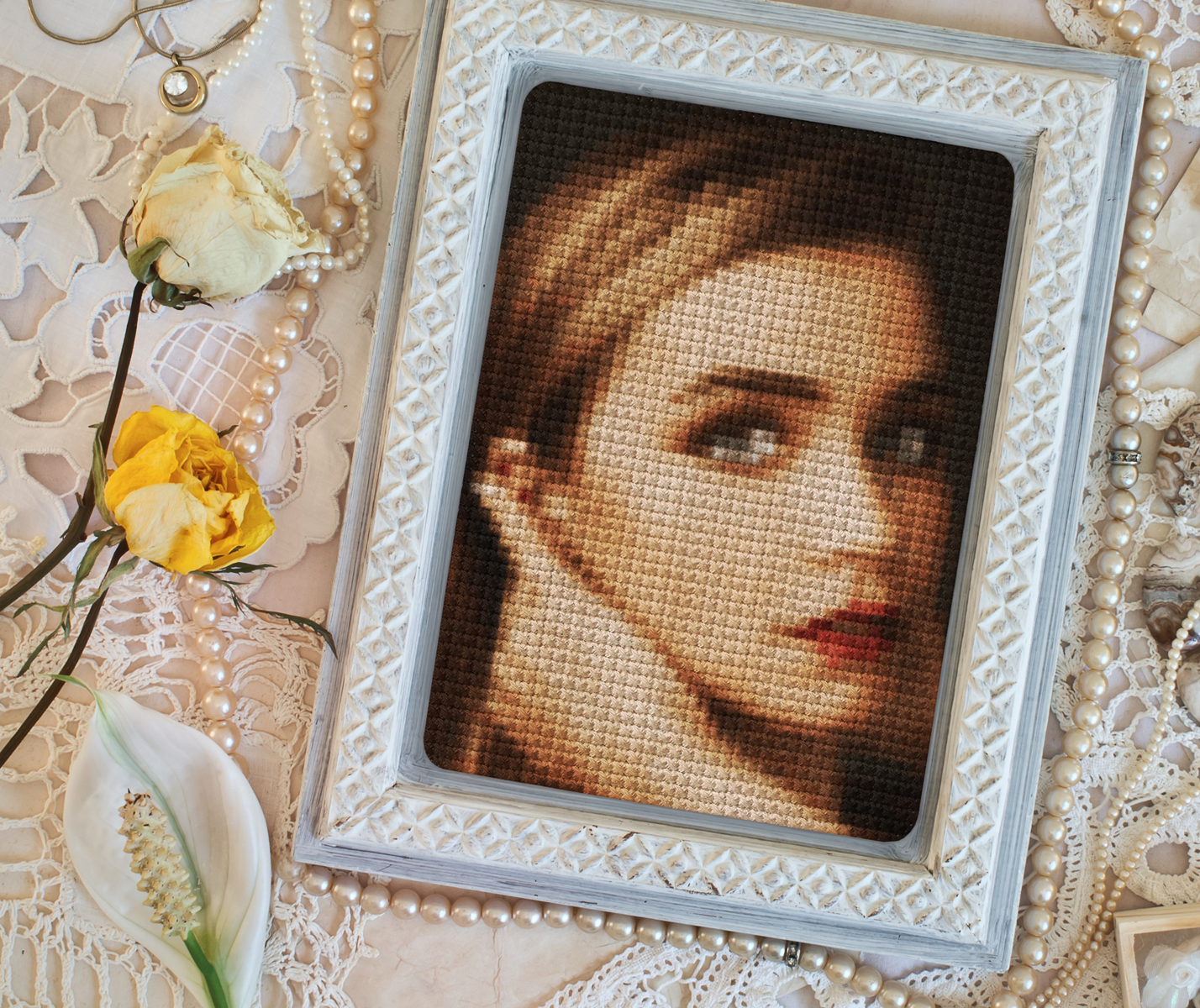A portrait of a woman was cross stitched online