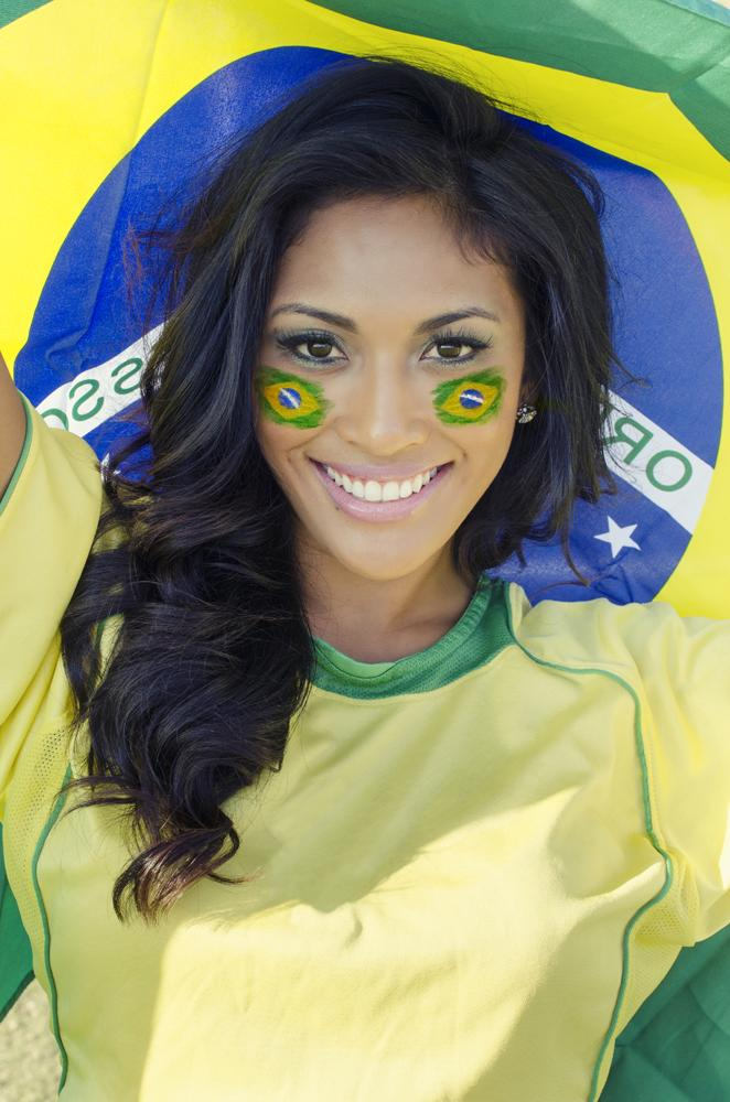 Flag of Brazil virtually painted on a brazilian woman's face.