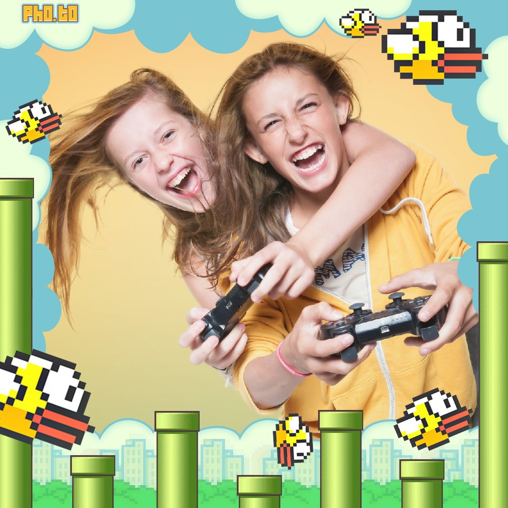 The picture shows two girls having fun playing Flappy Bird game.