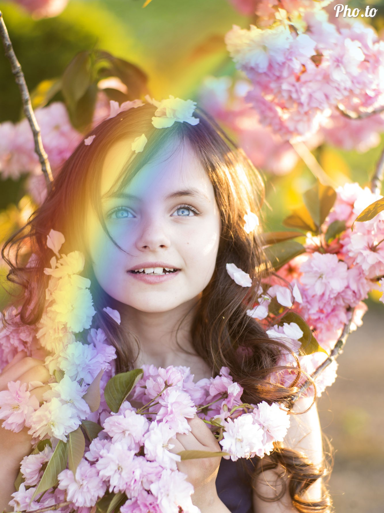 Rainbow filter added to a photo of a cute girl standing in flowers.