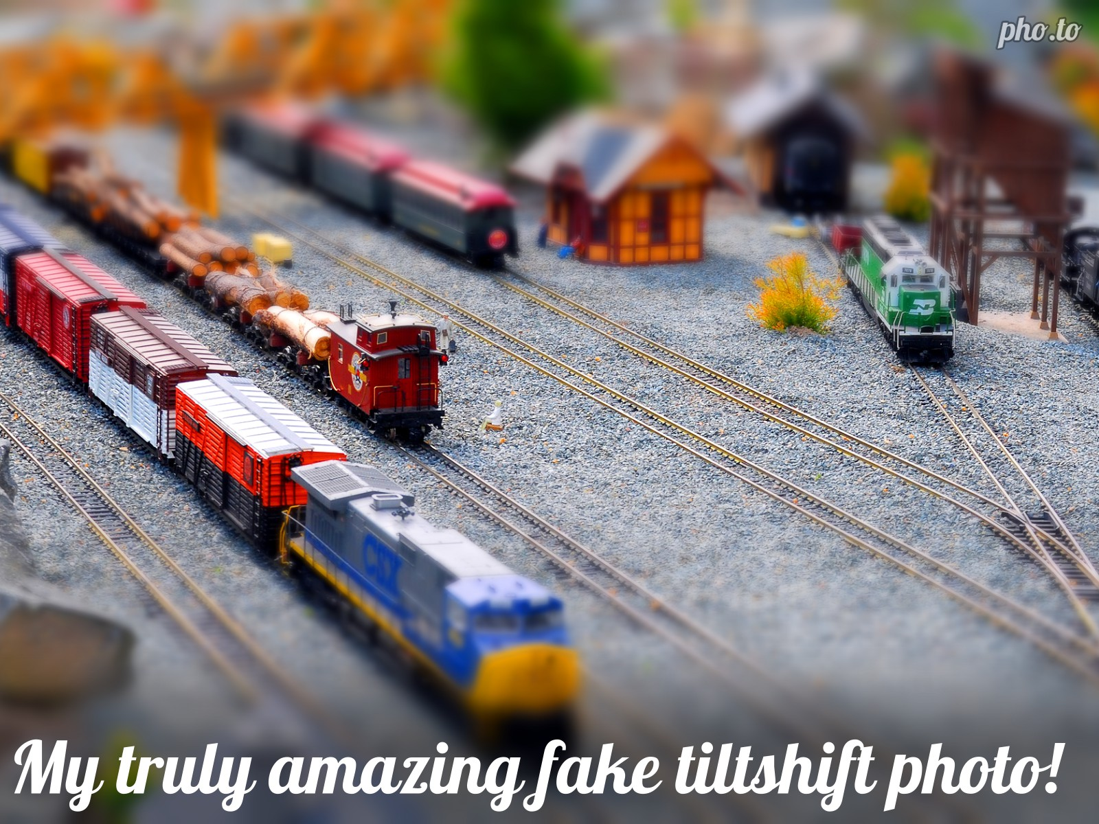 Tilt-shift effect is added to the view of   moving trains on the railroad