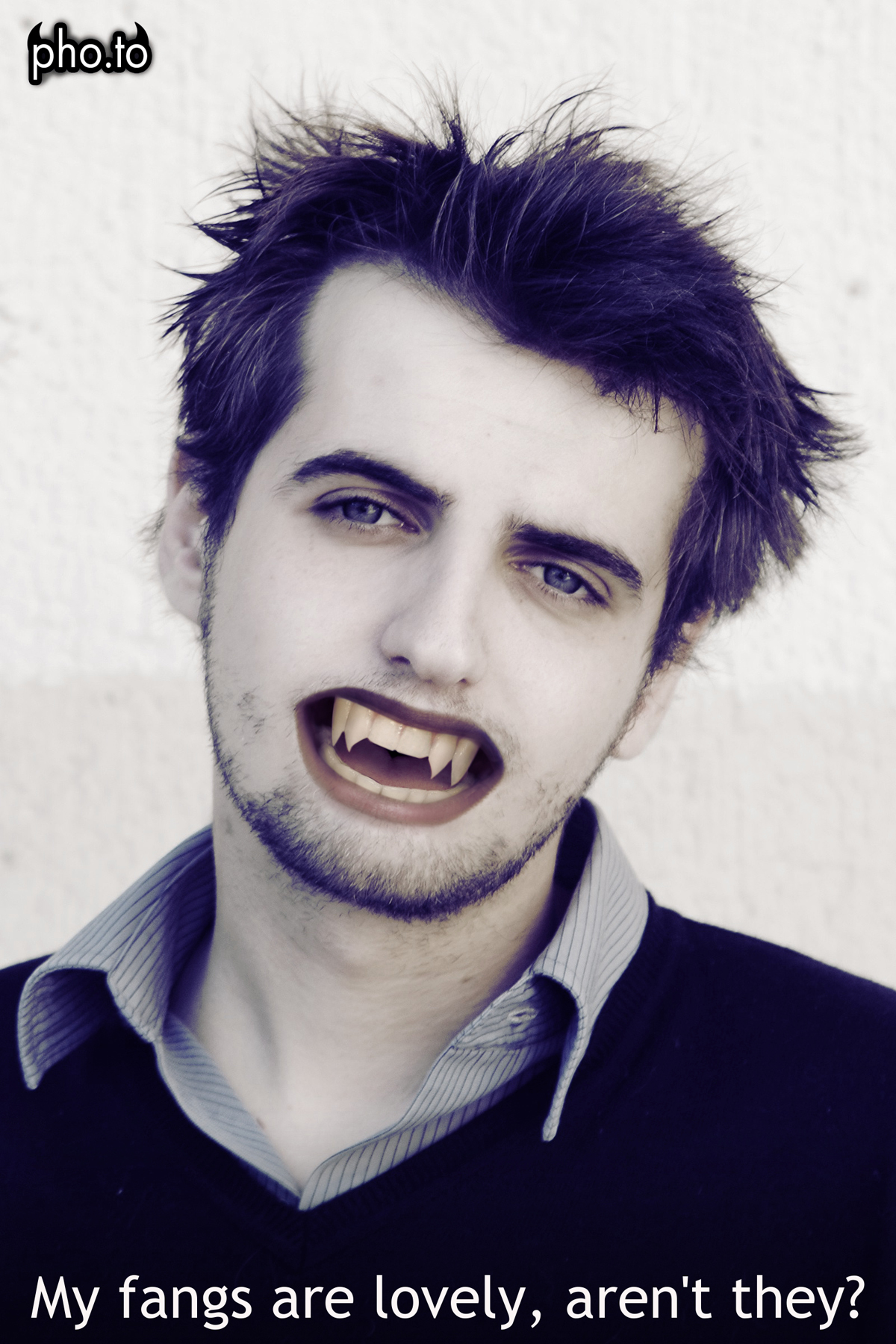 A boy with Halloween fake teeth added online with the help of 'vampire me' photo effect.