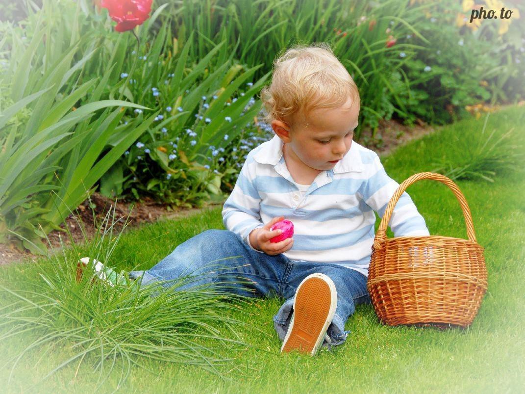 Subtle white vignette is added to a little boy's portrait